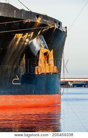 A bow of a tanker ship with anchor.