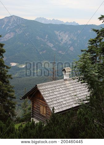 Small Hiking Rest House on Cliff Overhang with View of Forest Mountains