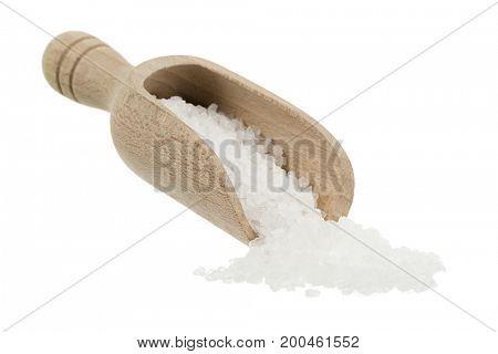 Wooden shovel of sea salt isolated on white background.