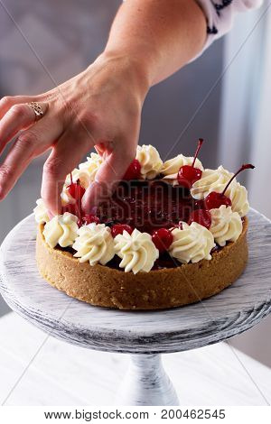 Cheesecake decorated with cherry sauce with berries