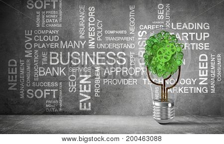 Glass lightbulb with tree from gears inside placed against business related terms on grey wall on background. 3D rendering.