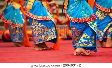 Asian travel background. Beautiful Balinese dancer woman in traditional Sarong costume dancing Legong dance. Legs movements. Arts culture of Indonesian people Bali island festivals. poster