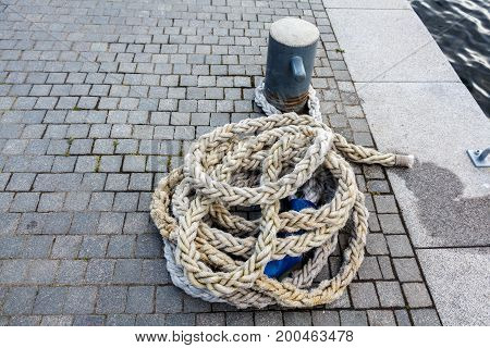Gray Nautical Rope On A Stone Pavement Pier