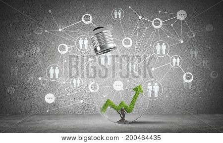 Lightbulb with green growing graph inside placed against sketched social network system on grey wall. 3D rendering.