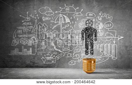 Lightbulb with human from gears inside placed against business-analytical information sketched on grey wall. 3D rendering.