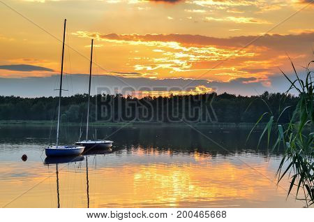 Boats on a beautiful lake. Evening summer landscape by the water.