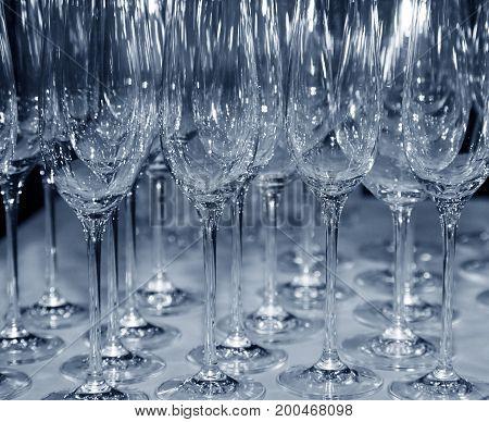 Wine glasses in lines. B/w + blue tone