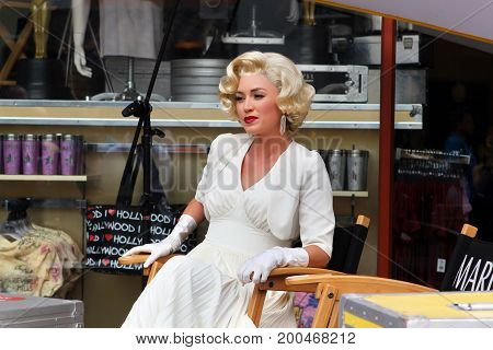 Hollywood CA USA - August 17 2012: Blond girl model like Marilyn Monroe in the Universal Studios Hollywood.