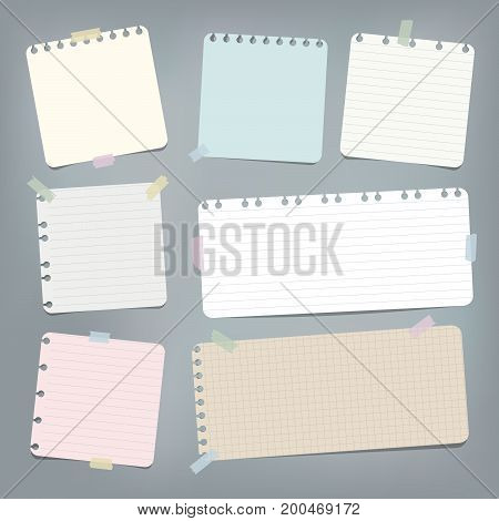Colorful striped, ruled note, copybook, notebook paper stuck with sticky tape on grey background