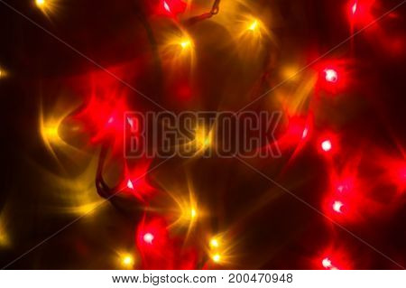 Red and yellow holiday bokeh. Abstract Christmas background.