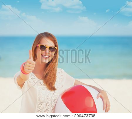 Redhead With Toy Ball At The Beach.