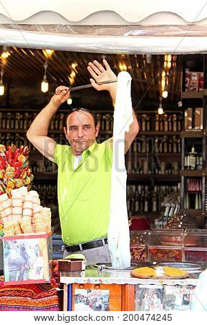 SIRINCE, TURKEY - APRIL 30, 2012: Ice cream seller in Sirince, Turkey. In this place the ice-cream is made of flowers