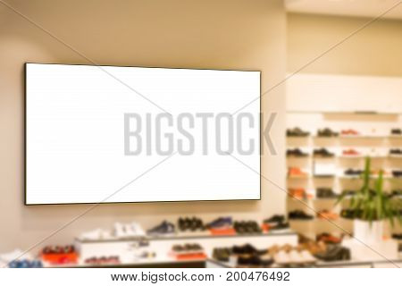 Mock up. Blank billboard, poster frame, advertising on the the wall inside in shoes store.