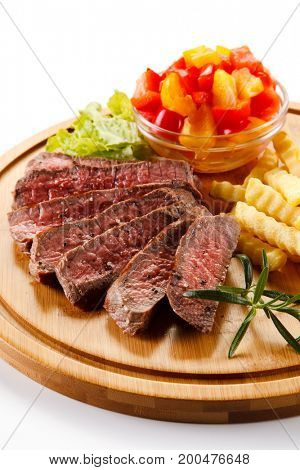 Grilled meat with french fries on white background