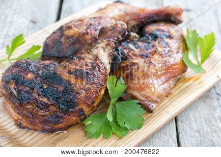 Grilled Roasted chicken legs with a thyme