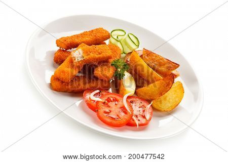Fried fish fingers, potatoes and vegetables