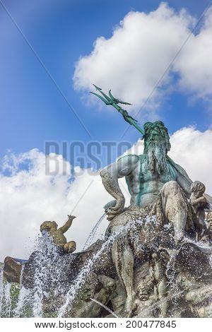 Neptune fountain in Alexanderplatz square. Berlin, Germany