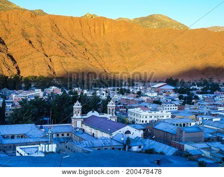 Small town of Tupiza covered by shadow just before dusk. Southern Bolivia, South America.