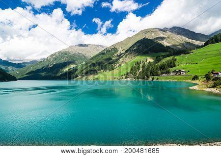 Landscape with lake and small spiaggetta lawn of the Trentino Alto Adige