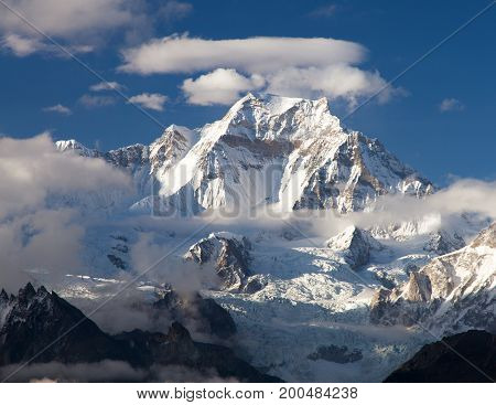 View from Gokyo Ri to mount Gyachung Kang 7952m within clouds near Cho Oyu three passes trekking route Sagarmatha national park Khumbu valley Nepal