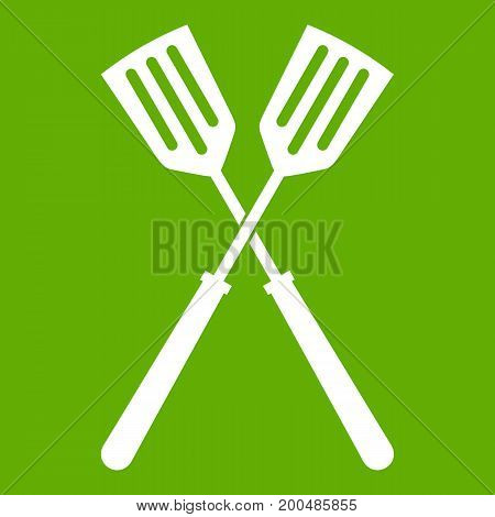 Two metal spatulas icon white isolated on green background. Vector illustration