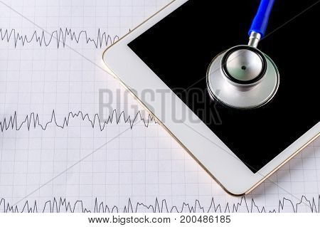 Medical Equipment: Blue Stethoscope And Tablet With Graph.