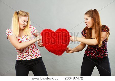 Two Agressive Women Having Argue Fight Holding Heart