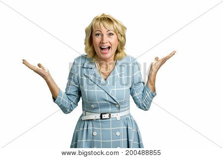 Surprised mature woman raised hands. Happy white-skin blonde in astonishment raised her hands on white background. Human emotions and facial expressions.