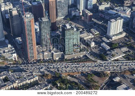 Los Angeles, California, USA - August 7, 2017:  Aerial view of new high rise tower construction along the jammed Harbor 110 freeway in downtown LA.