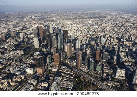 Los Angeles, California, USA - August 7, 2017:  Afternoon aerial view of urban downtown towers and streets along the Harbor 100 freeway.