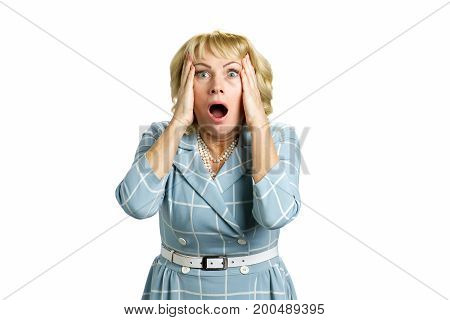 Portrait of woman with shocked reaction. Frustrated mature woman in full disbelief looking shocked isolated on white background.
