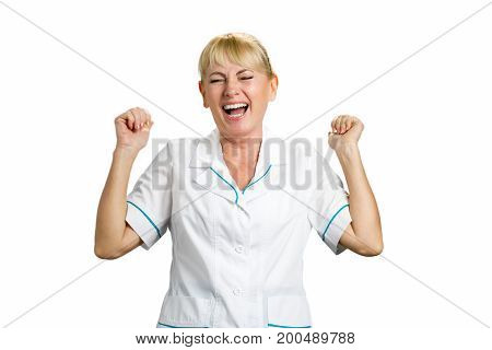 Joyful nurse on white backgound. Laughing medical mature female doctor with raised hands on white background.