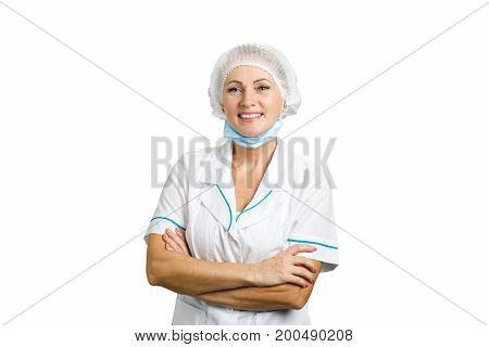 Cheerful female doctor crossed arms. Happy female surgeon standing arms crossed isolated on white background.