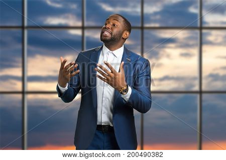 Black businessman passionately speaking. Afro american man in formal style speak with gesture on conference. Interactive seminar about business strategy.