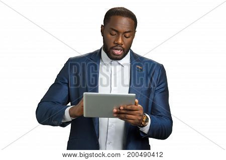 Black businessman with digital tablet. Beard afro american manager holding computer tablet and speaking.