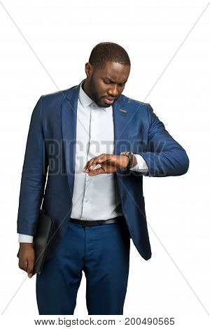 Manager with folder looking at watch. Handsome businessman checking the time. Busy man in formal wear waiting for meeting.
