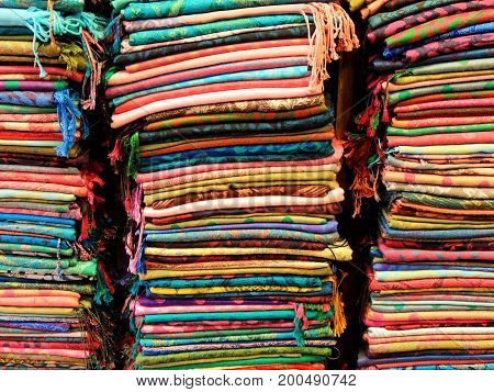 Stacks of delicate Turkish scarves at the market