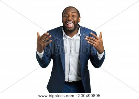 Expressively smiling businessman, white background. Young attractive gesticulating businessman with sincere smile. Emotionally gesticulating businessman.