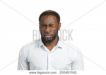 Dark skinned man with closed eyes. Afro american man in white shirt on white background closed eyes. Exhausted businessman want to sleep.
