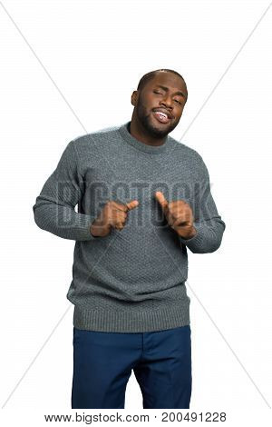 Black man showing thumb up. Excited black man with squinty eyes. positive guy in casual sweater on white background.