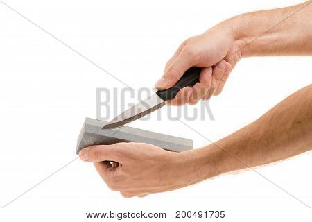 Male hand sharpen on a white background Isolation