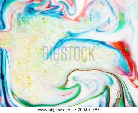 Abstract Colorful Backgrounds and Textures. Various colors of the Rainbow swirl and twist in a Psychedelic pattern reminiscent of the 1960's hippie drug culture.