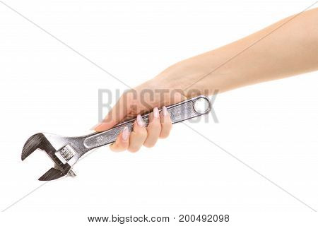 Adjustable wrench in a female hand on a white background isolation