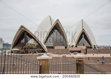 SYDNEY,NSW,AUSTRALIA-NOVEMBER 19,2016: Sydney Opera House with tourists on an overcast day in Sydney, Australia.