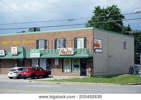 CREST HILL, ILLINOIS / UNITED STATES - JULY 19, 2017: One may have one's nails trimmed at Beautiful Nails, or purchase gifts and view the Rock and Mineral Show at O'Bryant's Boutique, in the Crest Hill Plaza on Plainfield Road.