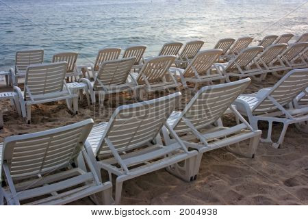 Chaise-Longues In Sunset
