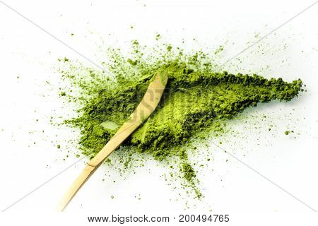 Matcha powder spread with a chashaku spoon. Matcha is made of finely ground green tea powder. It's very common in japanese culture. Matcha is healthy due to it's high antioxydant count.