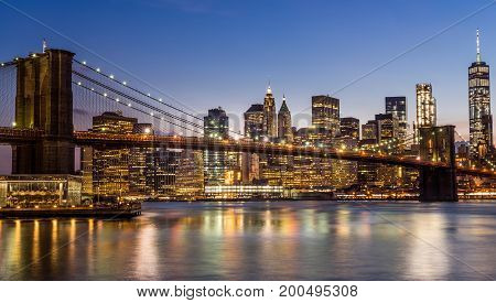 Evening view of Brooklyn Bridge and Manhattan from Brooklyn Dumbo area.