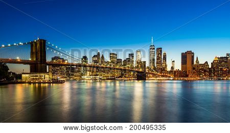 Evening view of Downtown Manhattan with Brooklyn Bridge from Brooklyn Dumbo area