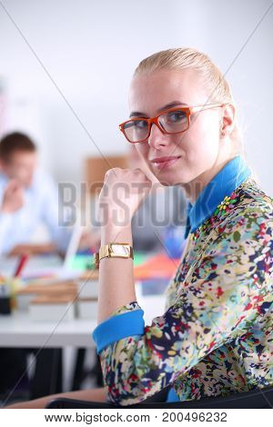 Portrait of attractive female designer in office. Female designer.